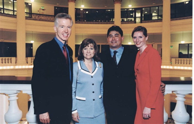 Gov. Gray Davis and his wife, Sharon, visit Phil and his wife, Jessica, at the Rotunda Building in 2002.