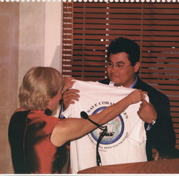 Phil receives a t-shirt in 2003 as part of his recognition for helping keep the Coral Reef Foundation scientific research organization afloat.